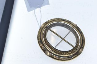 Large yellow metal double sided swivel mourning brooch, the outer frame tests positive for 9ct gold,