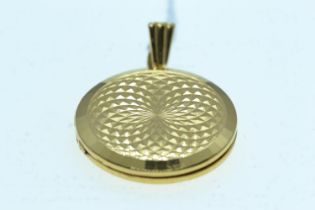 9ct gold locket, diameter 26mm, length including bale 37mm, gross weight 7.27 grams