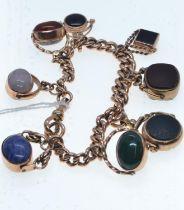 9ct gold bracelet suspending eight hardstone set swivel fobs, 205mm circumference, gross weight 70.1