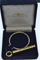 Scrap gold comprising 9ct gold pendant single earring & yellow metal hoop earring tested positive fo