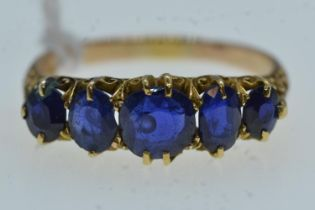 Yellow metal & five stone sapphire ring, tests positive for 18ct gold, size N, 2.87 grams