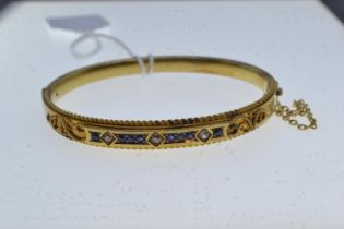15ct gold, diamond & sapphire hinged bangle, inner width approximately 57mm, 11.31 grams