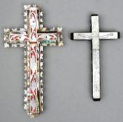 Zwei KruzifixePerlmutt, Holz (1) Kruzifix mit ornamentalen Muster, teilweise koloriert, leich