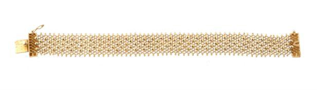 A Lebanese gold coloured woven bracelet