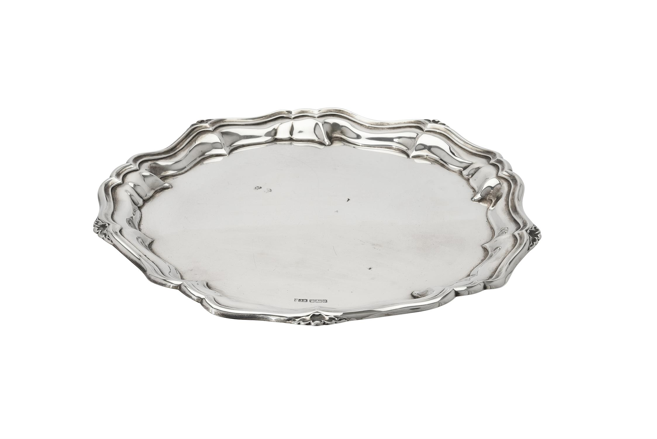 An Edwardian silver shaped circular salver by Joseph Rodgers & Sons