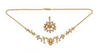 An Edwardian half pearl necklace with brooch/pendant