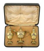 A cased matched Edwardian silver gilt three piece cruet set