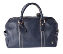 Louis Vuitton, a blue taurillon leather Keepall