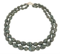 An early 20th century turquoise matrix bead necklace