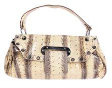 Y Dolce & Gabbana, a python skin handbag