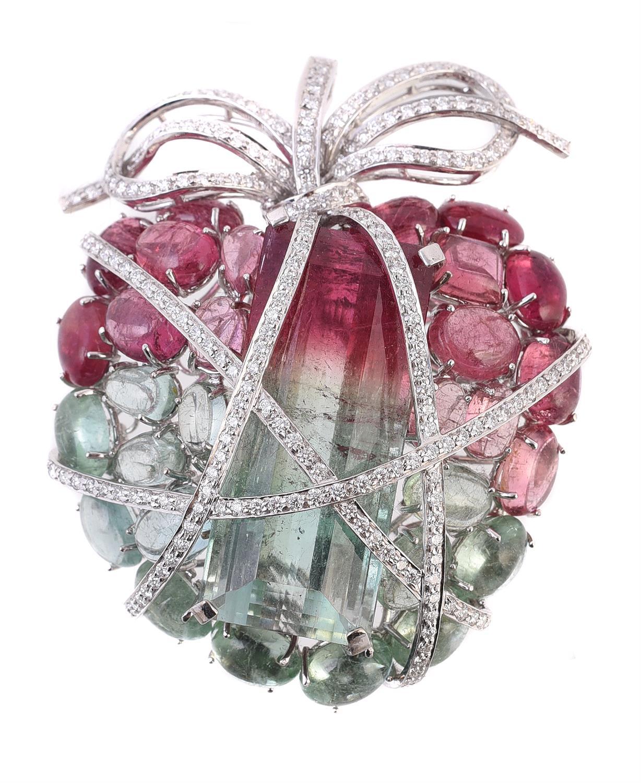 A diamond and tourmaline wrapped heart brooch