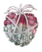 A diamond and tourmaline wrapped heart brooch