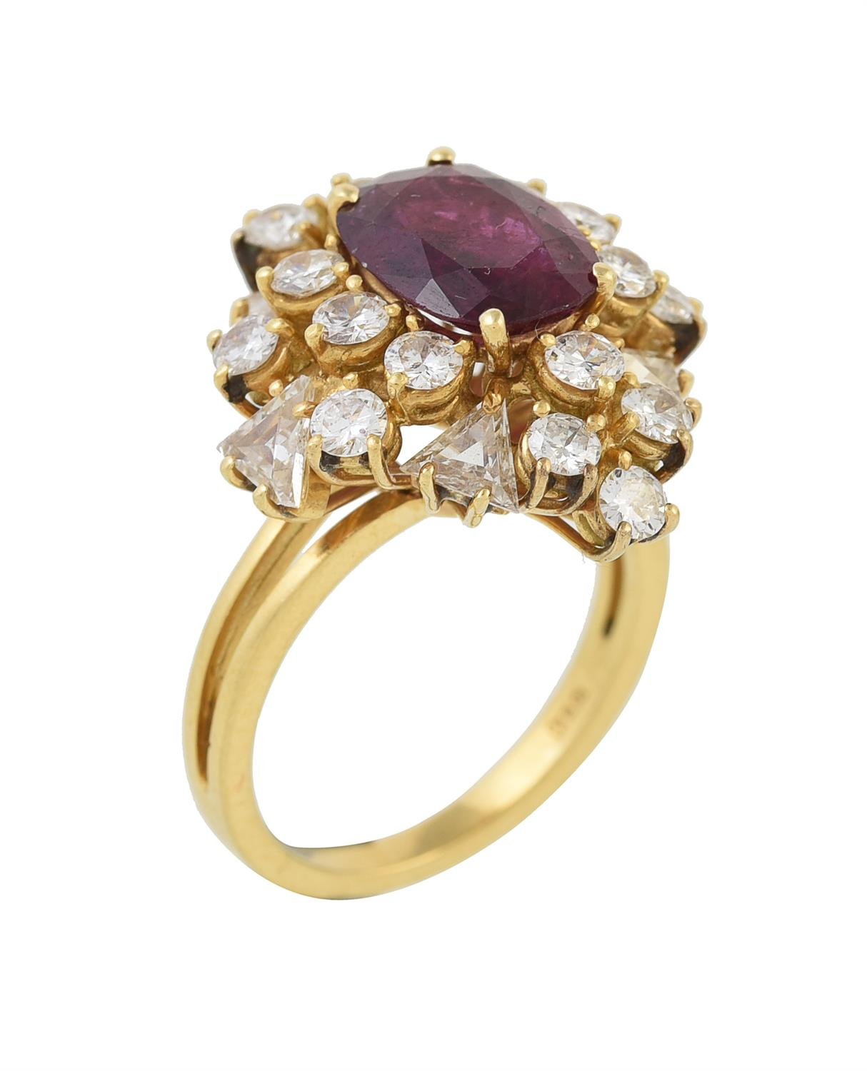 A ruby and diamond cluster dress ring