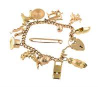 A vintage curb link charm bracelet