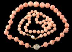 Y A graduated coral bead necklace