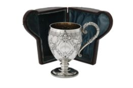 A cased Victorian silver christening mug by Martin, Hall & Co.