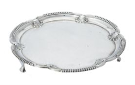 A silver shaped circular salver by Elkington & Co. Ltd.