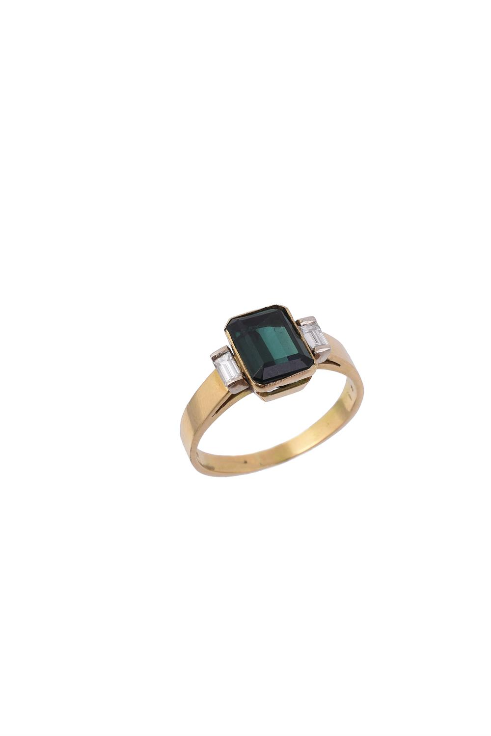 A green tourmaline and diamond three stone ring