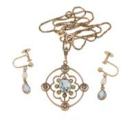 An Edwardian aquamarine and seed pearl pendant