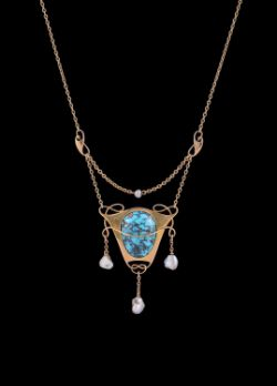 A turquoise matrix and freshwater pearl pendant necklace by Murrle Bennett & Co.