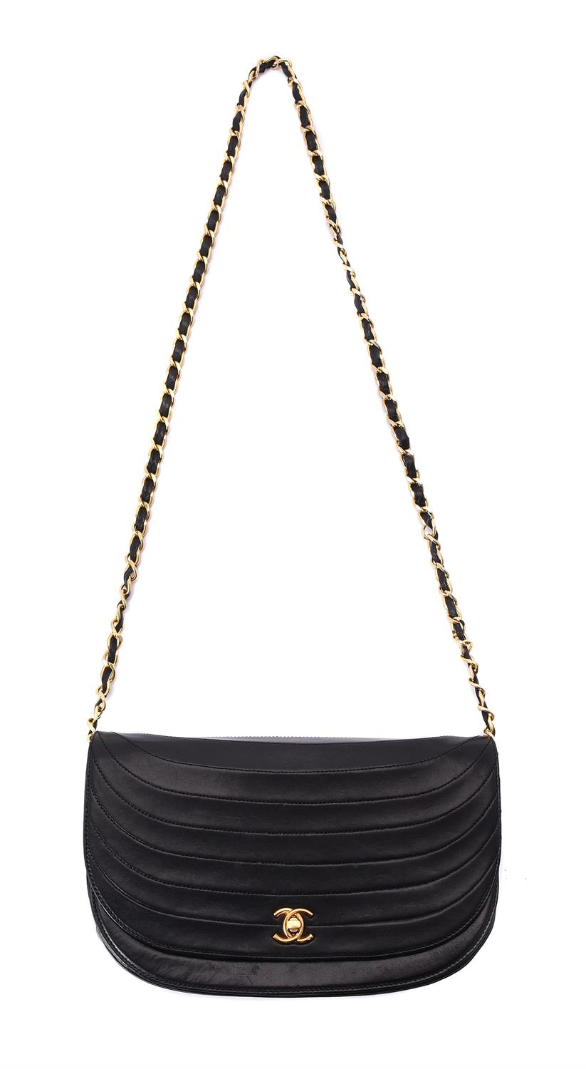 Chanel, a vintage black leather flap bag
