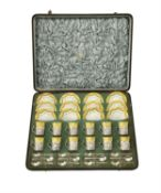 An Edwardian cased silver mounted coffee set for twelve