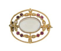A 1920s gold Murrle Bennett & Co. ruby, seed pearl and moonstone brooch