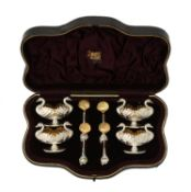 A cased set of four silver swan salts and spoons by Hilliard & Thomson