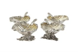 A set of four silver shell shaped salts by S. Blanckensee & Son Ltd.