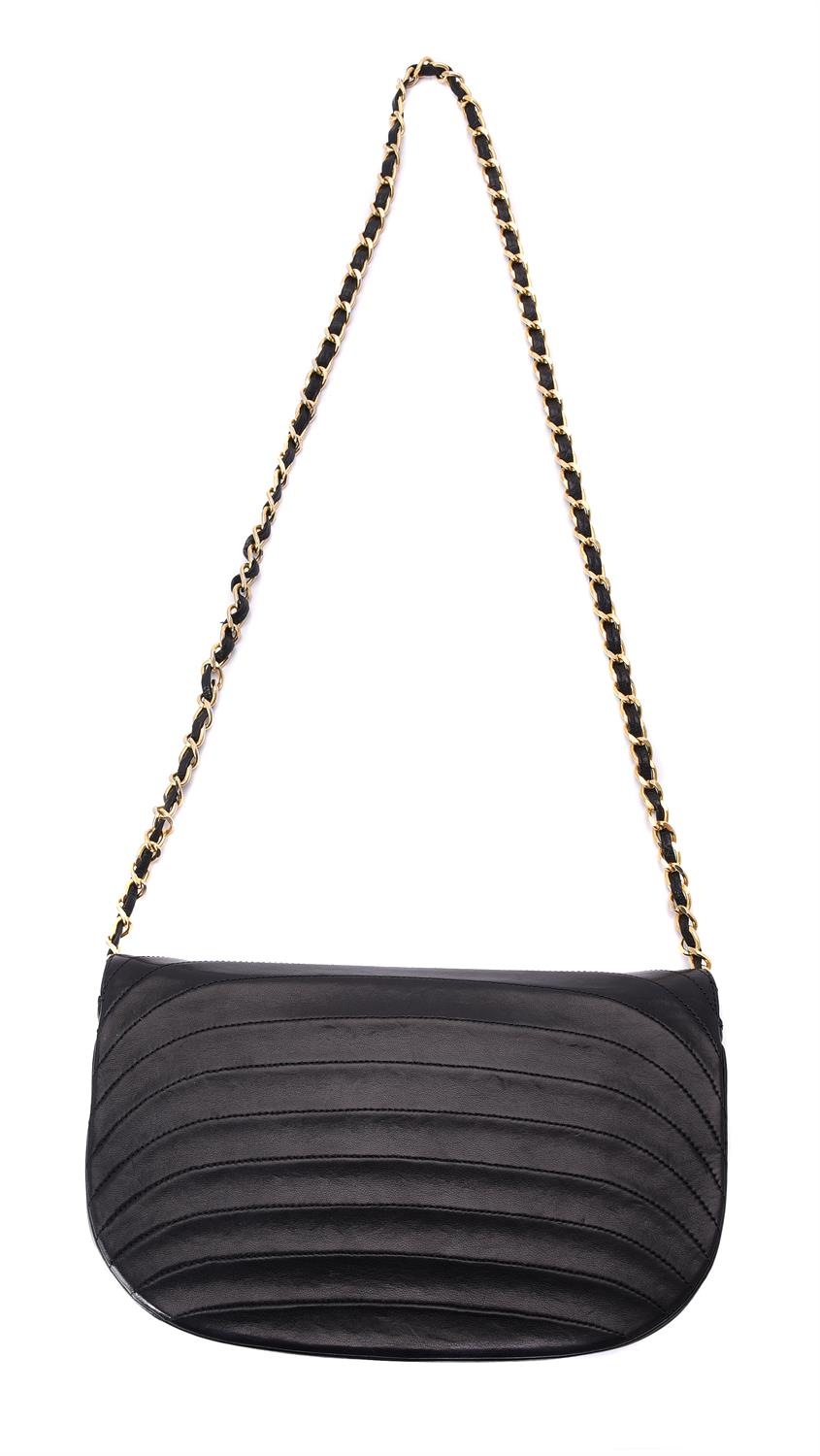 Chanel, a vintage black leather flap bag - Image 2 of 3