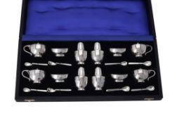 An assembled cased silver cruet set