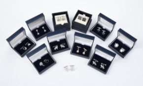 A collection of silver cufflinks