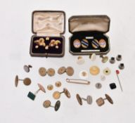 A collection of dress studs and cufflinks