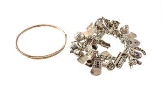 An Edwardian seed pearl set gold bangle