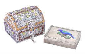 A silver coloured and precious stone set and pierced casket