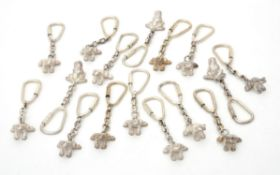 A collection of silver frog key rings