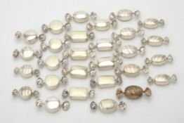 A collection of silver sweet shaped pill boxes