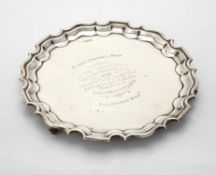 A silver shaped circular salver by Walker & Hall