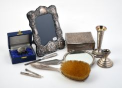 A collection of silver and silver coloured mounted items