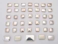 A collection of silver plain rectangular boxes
