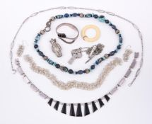 A small collection of silver coloured jewellery