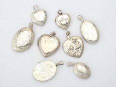 A collection of silver and silver coloured lockets