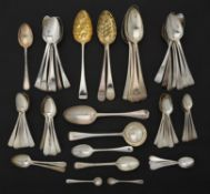 A collection of silver and silver coloured Old English pattern spoons