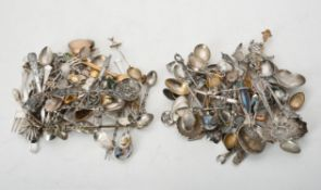 A collection of silver, silver coloured and electro-plated spoons