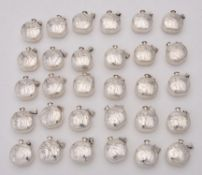 A collection of silver scent bottles