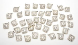 A collection of silver pendant cases