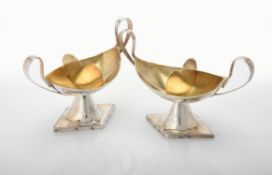 A pair of French silver twin handled oval pedestal salts