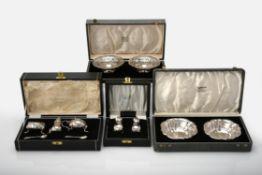 Four cased sets