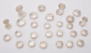 A collection of silver octagonal pill boxes