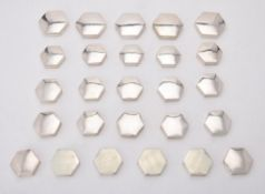 A collection of plain silver octagonal boxes